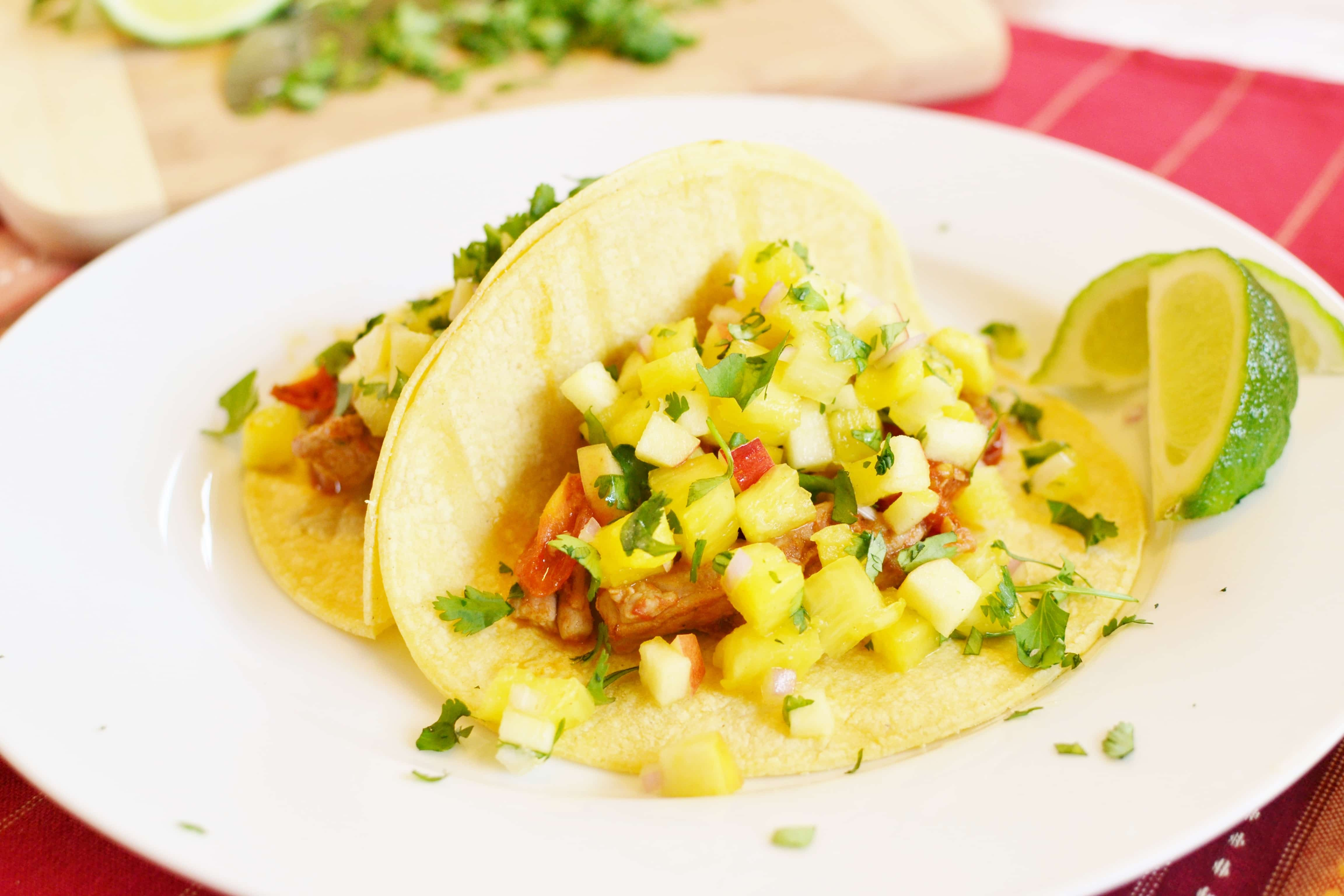 These 21 Day Fix Tacos have a delicious smoky pork filling and are topped with a sweet and tart pineapple salsa. A quick, easy and delicious dinner!