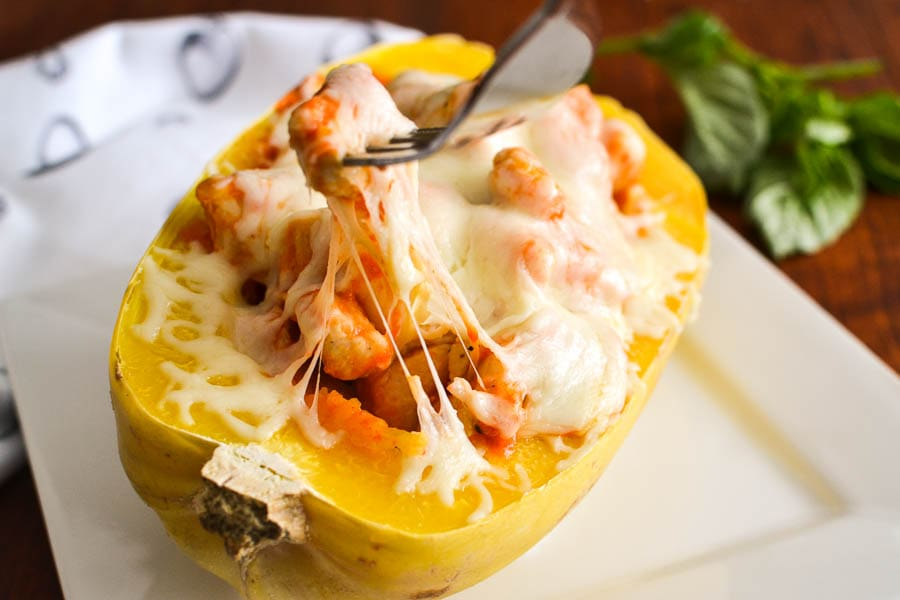 Cheesy Spaghetti Squash Boats with Chicken and Roasted Red Pepper Cream Sauce
