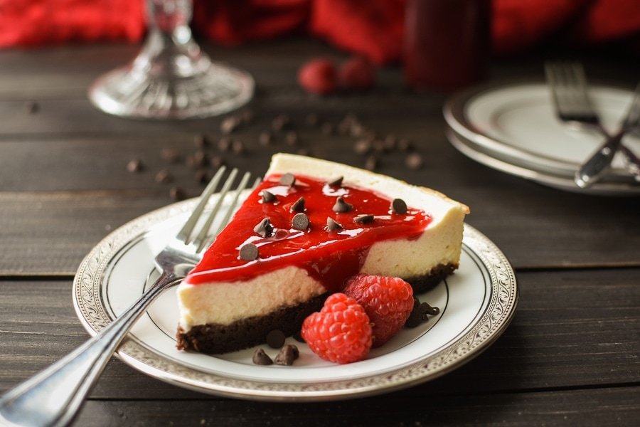 This healthy, 21 Day Fix Brownie-Bottom Cheesecake with Raspberry Sauce is the perfect make-ahead dessert for your holiday dinner or special occasion!