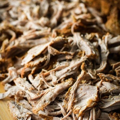 This Slow-Cooker 21 Day Fix Southwestern Pulled Pork Tenderloin makes a delicious, healthy base for tacos, BBQ sandwiches, soups and so much more! Make it on Sunday and use throughout the week for quick, easy dinners!