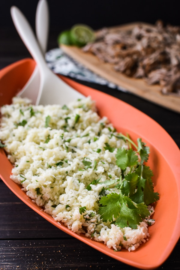 21 Day Fix Garlic-Cilantro Cauliflower Rice is an easy, flavorful side that will go perfectly with your favorite Mexican and Thai dishes.Gluten-Free | Vegan | Dairy-Free