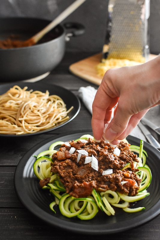 This Healthy Cincinnati Chili is a quick, easy, full-of-flavor, kid-friendly dinner! It's gluten free (served with zoodles or pasta). 21 Day Fix | Weight Watchers Freestyle Points #21dayfix #portionfix #quickdinner #gameday #weightwatchers #healthy #healthydinner #glutenfree #cincinnati #weightloss #mealprep #kidfriendly #familyfriendly
