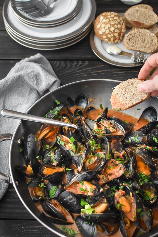 Steamed Mussels in Sherry-Tomato Broth make for an easy, inexpensive dinner or appetizer. A perfect Feast of the Seven Fishes recipe for Christmas Eve, too! #21dayfix #2bmindset #glutenfree #holiday #healthyholiday #appetizer #dinner #healthydinner #healthyappetizer #portionfix #quick #seafood #feastofthesevenfishes #italian