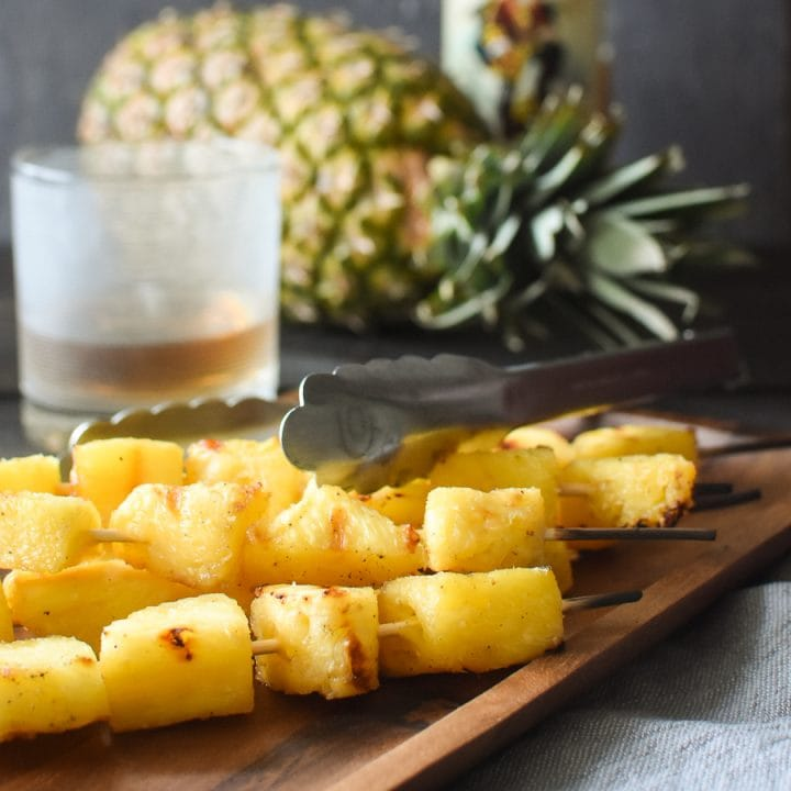 This simple rum-marinated grilled pineapple is full of flavor and a makes for a delicious, healthy side dish! It's also vegan, gluten free and dairy free! #21dayfix #ultimateportionfix #portionfix #weightwatchers #grill #grillrecipe #grilling #bbq #healthy #sidedish #healthyside #vegan #vegetarian #glutenfree #dairyfree #healthygrilling