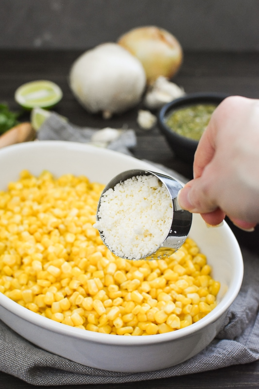 This Cheesy Salsa Verde Corn is a quick and easy side dish that's perfect for a potluck! Bonus: it only uses four ingredients and it's gluten-free! #21dayfix #healthy #cheese #weightwatchers #weightloss #mealprep #potluck #mexican #ultimateportionfix #portionfix #glutenfree #quick #sidedish #side #healthyside