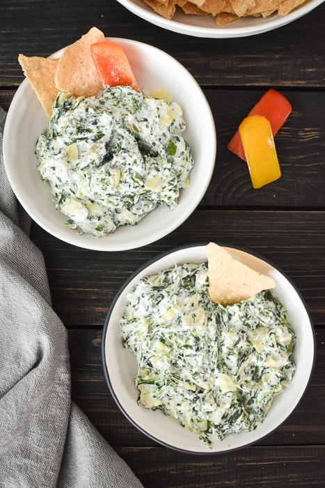 Quick Spinach and Artichoke Dip (made in Instant Pot or microwave) is the perfect last minute appetizer for any holiday or game day. Healthy, easy & delish! #21dayfix #weightwatchers #gameday #holiday #healthygameday #healthyholiday #snack #appetizer #healthysnack #healthyappetizer #mealprep #weightloss #kidfriendly #instantpot #microwave #party #partyfood #healthypartyfood