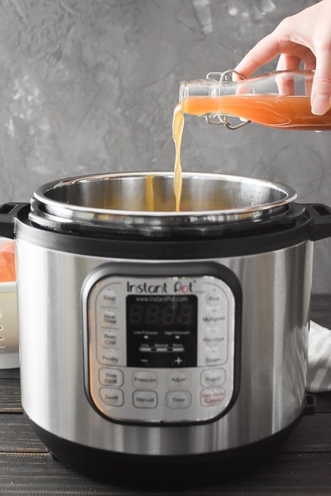 Apple cider being poured into an Instant Pot