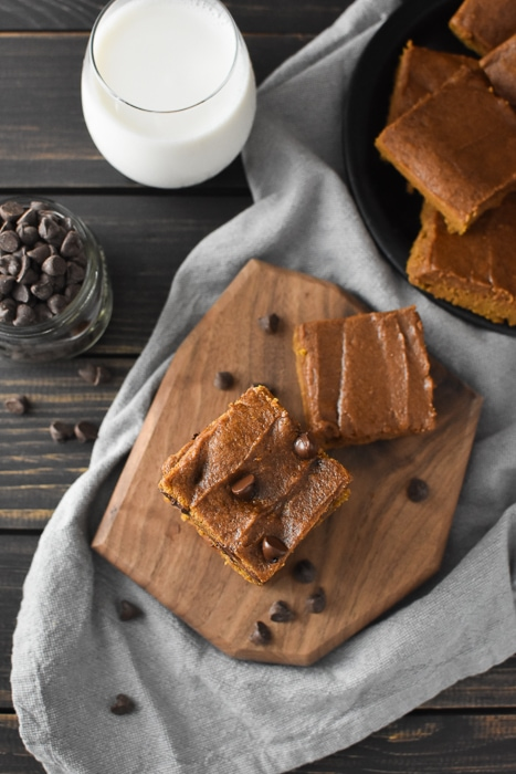 Pumpkin blondies on a wooden board