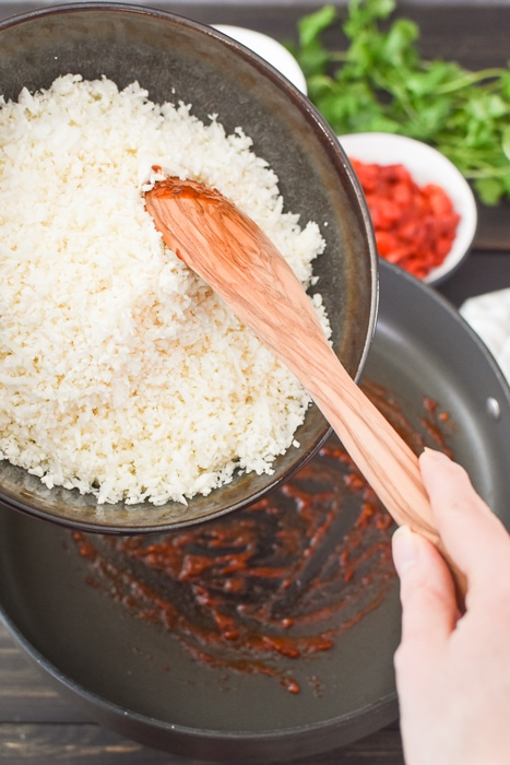 Adding cauliflower rice to a pan