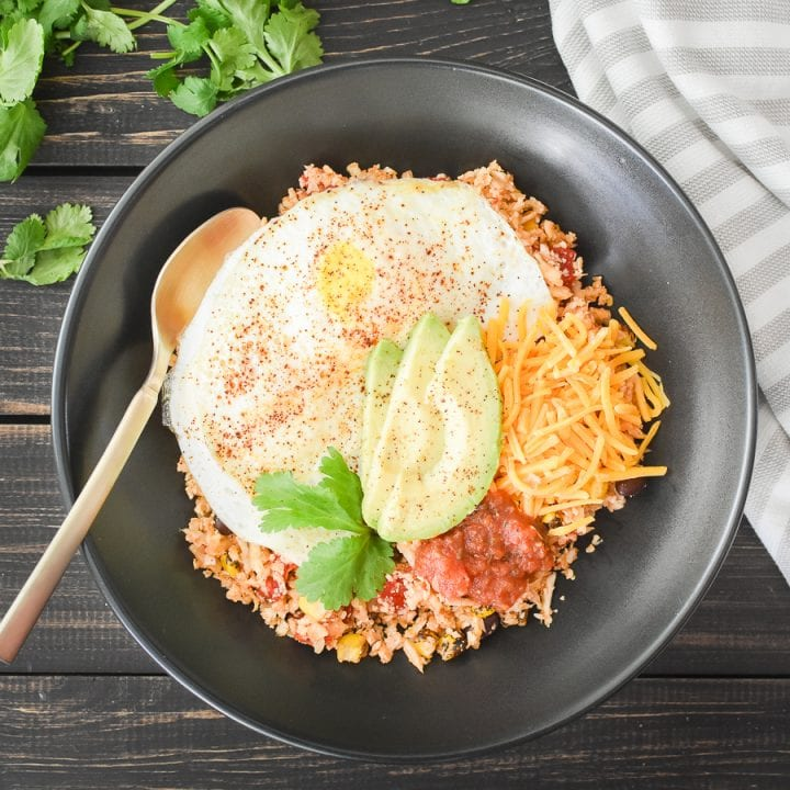 Eggs over fiesta rice in a bowl