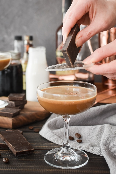 chocolate being grated over a cocktail