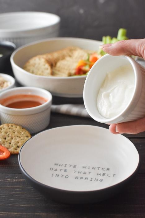 adding healthy dip base to a bowl