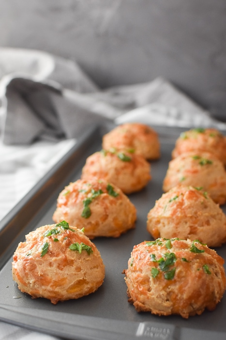 a baking sheet full of whole wheat cheddar bay biscuits