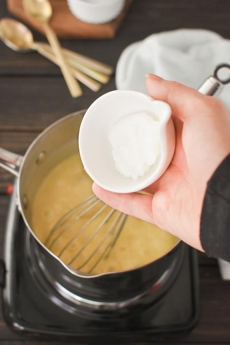 Adding coconut oil to vanilla pudding.