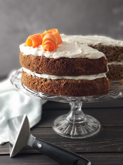 2 layer carrot cake on cake stand