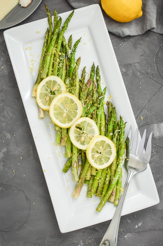 Lemon-Pecorino Air Fryer Asparagus on a white plate