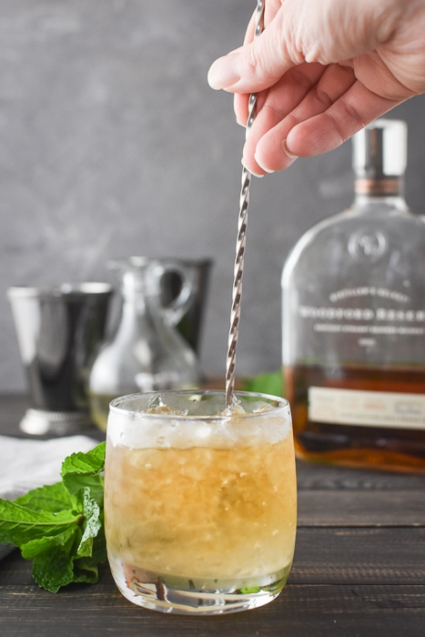 a 21 Day Fix mint julep being stirred