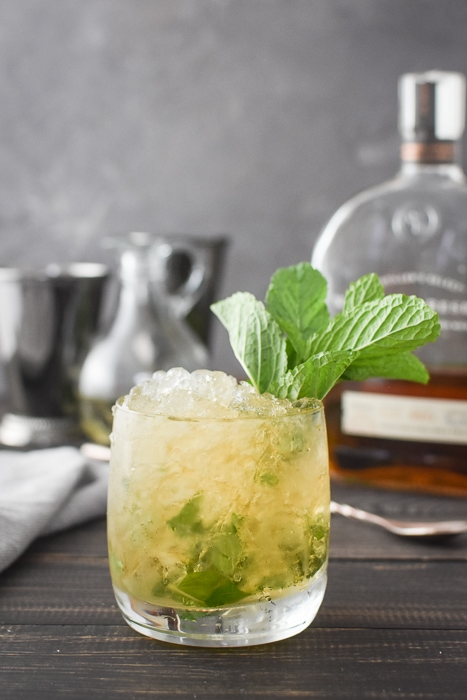 a 21 Day Fix mint julep with a bottle of bourbon and two julep cups