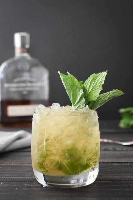 a 21 Day Fix mint julep with a bottle of bourbon