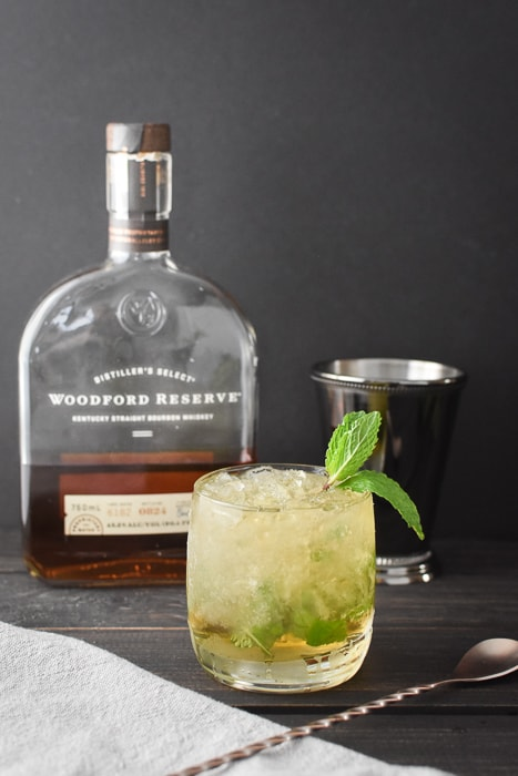 a 21 Day Fix mint julep with a bottle of bourbon and a julep cup