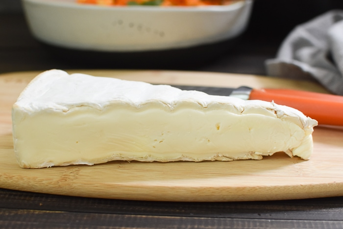 a wedge of brie cheese