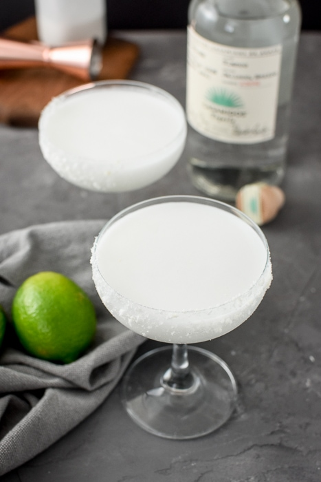two skinny Coconut-Lime Margarita in a coupe
