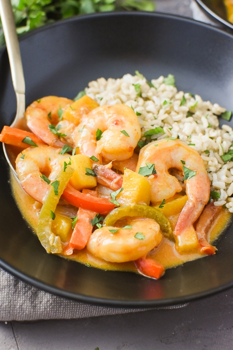 Thai Mango Curry with Shrimp in a bowl with rice