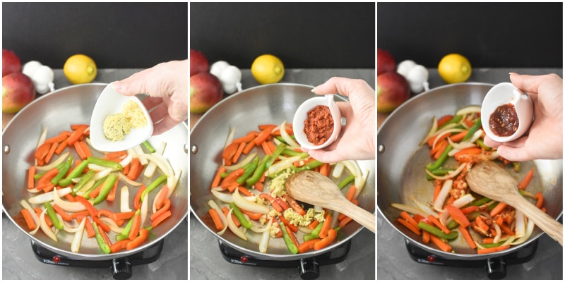 adding ginger, garlic, curry paste and chili paste to a pan of veggies for a curry